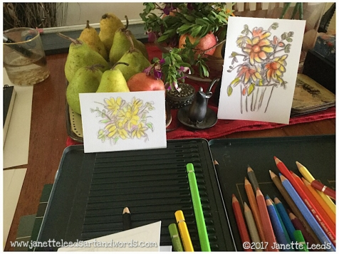 Photo of pencils and two watercolours